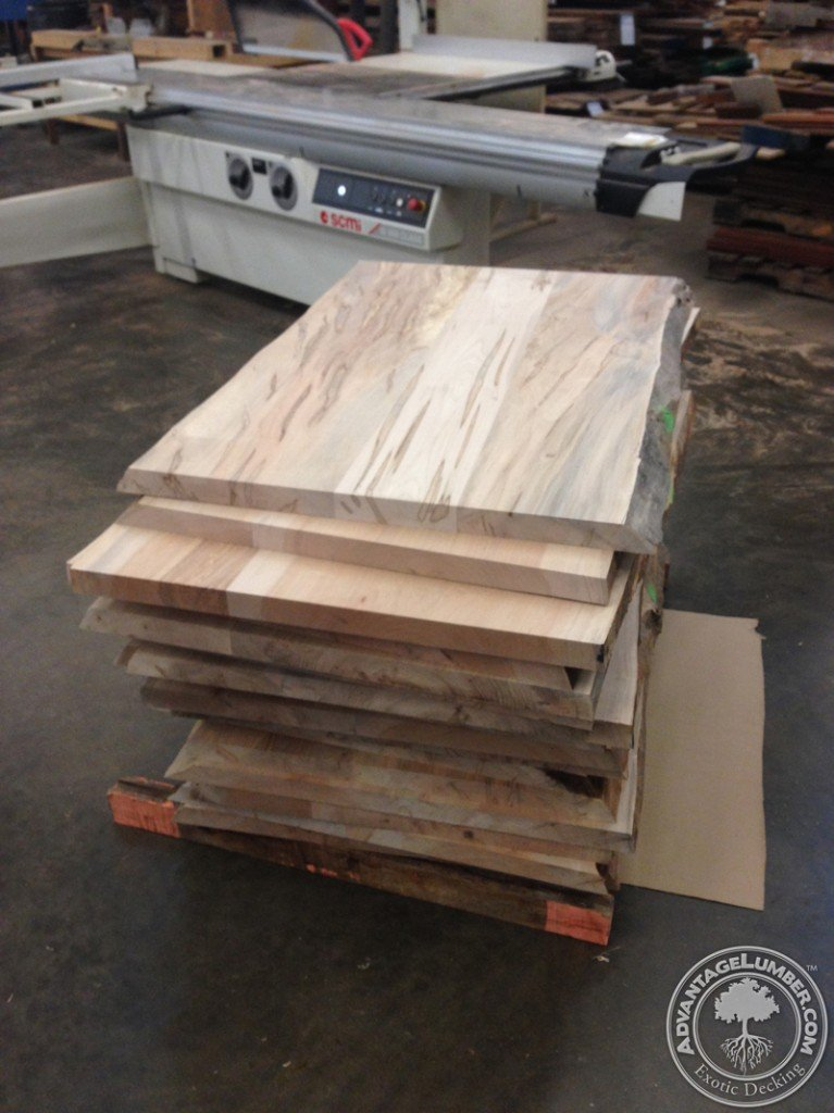 Ambrosia table tops with live edges being prepared to be shipped to a chain of restaurants in North Carolina, South Carolina, and Florida