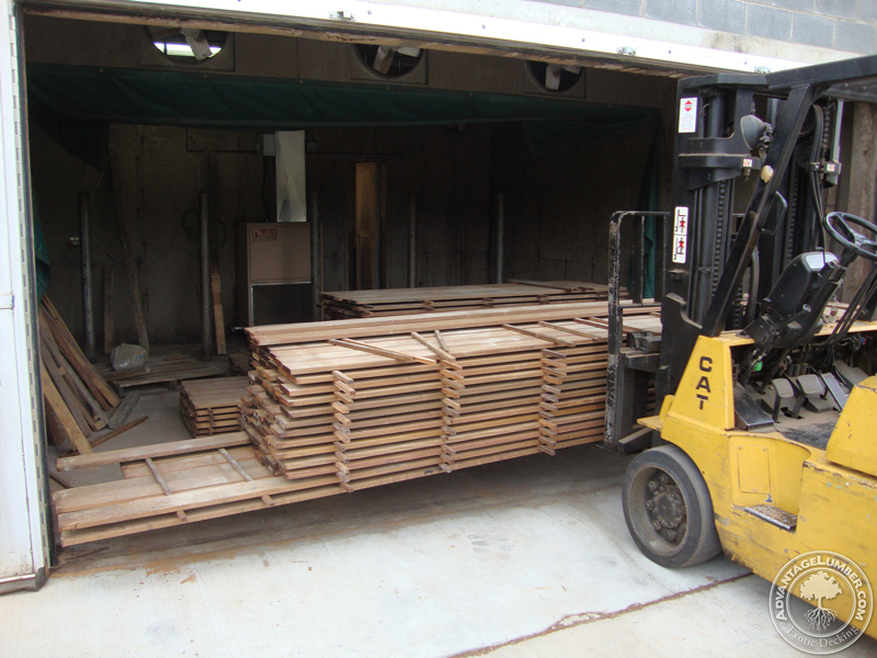 Brazilian hardwood being taken out of our North Carolina kiln after reaching a moisture content for interior use