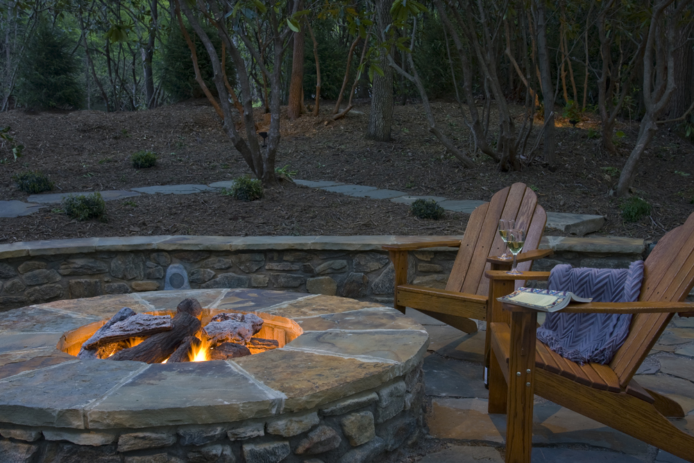 A traditionally built fire pit incorporated in the back yard